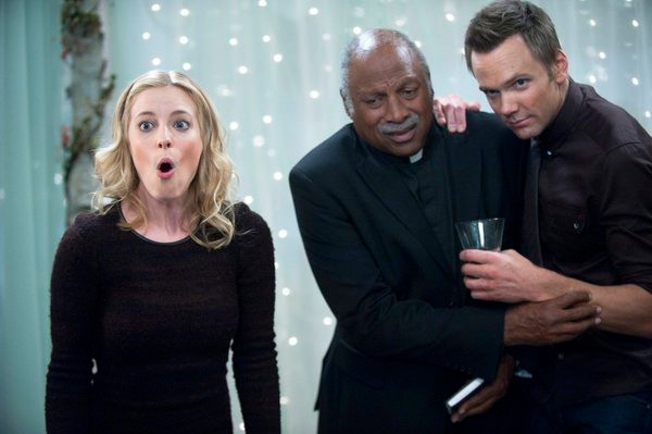"COMMUNITY -- ""Urban Matrimony and the Sandwich Arts"" Episode 312 -- Pictured: (l-r) Gillian Jacobs as Britta, Charles Walker as Minister, Joel McHale as Jeff -- Photo by: Lewis Jacobs/NBC"