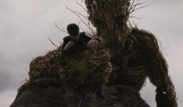"""Lewis MacDougall and Liam Neeson in """"A Monster Calls."""""""