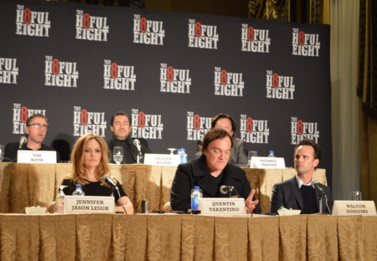 """Tim Roth, Jennifer Jason Leigh, Demian Bichir, Kurt Russell, Quentin Tarantino, Michael Madsen and Walton Goggins at the New York Press Conference for """"The Hateful Eight."""" Photo copyright 2015 Jay S. Jacobs."""