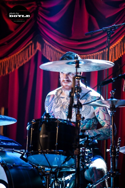 Andy Hurley of Fall Out Boy in concert in New York.  Photo copyright 2013 by Mark Doyle.