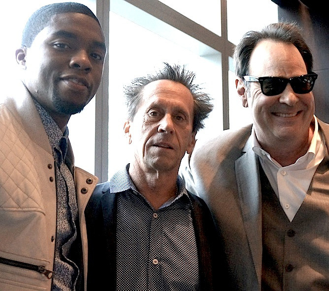 "Chadwick Boseman with Brian Grazer and Dan Aykroyd at the New York Press Conference for ""Get On Up."" Photo by Brad Balfour copyright 2014."