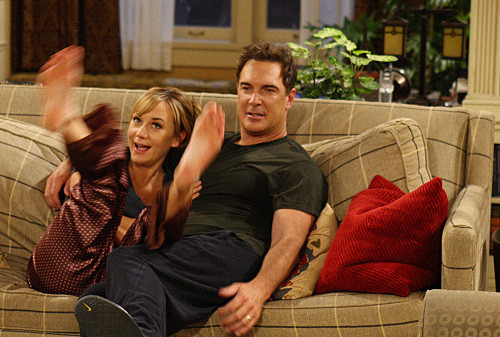"""""""Lyin' King""""--Jeff (Patrick Warburton) and Audrey (Megyn Price) come up with a lie to get out of going to a party at Adam and Jennifer's, on RULES OF ENGAGEMENT Monday, March 30 (9:30-10:00 PM, ET/PT) on the CBS Television Network. Photo: Robert Voets/CBS ©2008 CBS Broadcasting Inc. All Rights Reserved."""