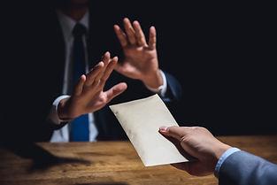 businessman-rejecting-money-envelope-ant