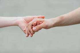 couple-holding-hands-grey-background_23-