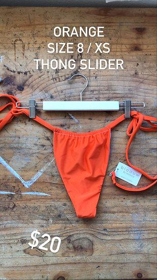 Shiny Orange slider style thong (size 8)
