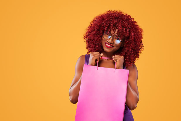 Afro american woman at shopping holding