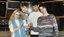 9141-clean_bandit_with_their_official_number_1_award_for_rather_be_420x250.jpg