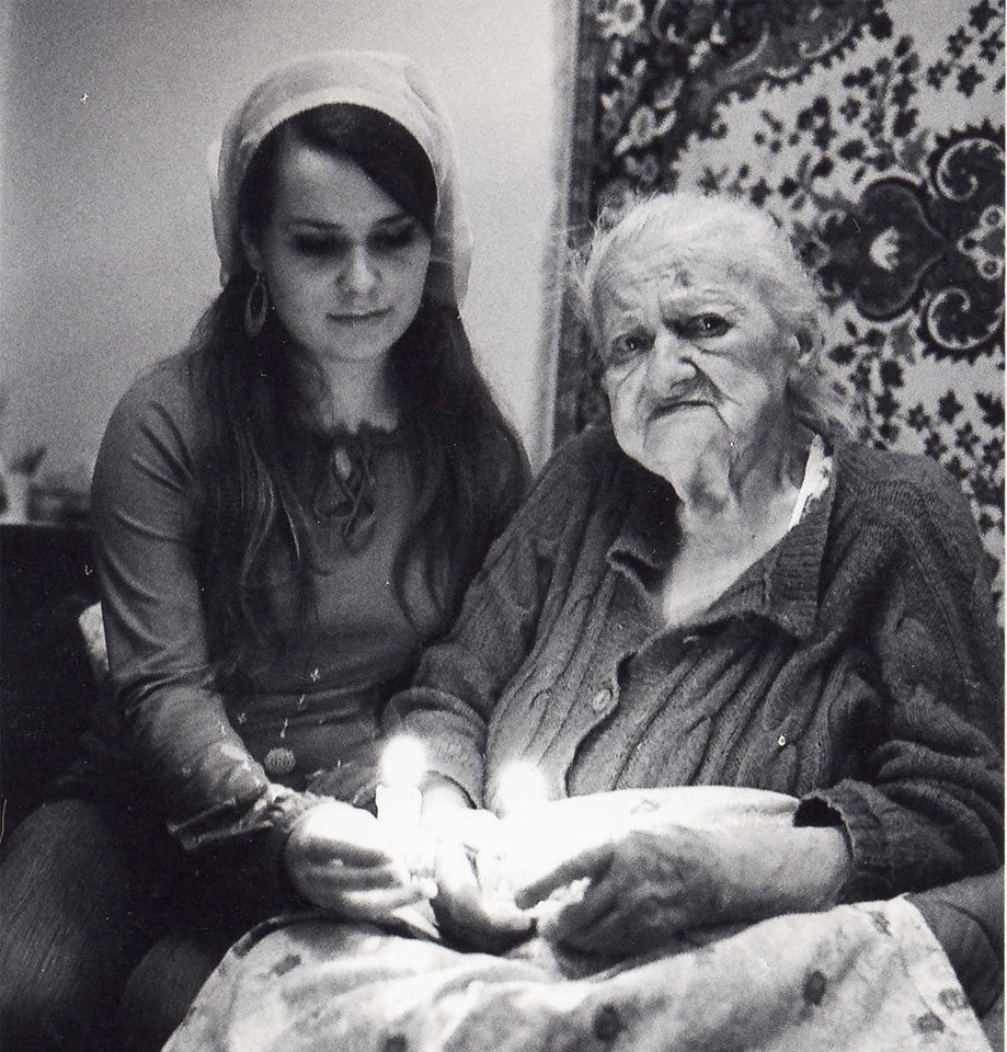 1.Holocaust surviver grandmother lights the Sabbath candles with her granddaughter in the Ukraine-2006. Silver print on Fiber based paper..jpg