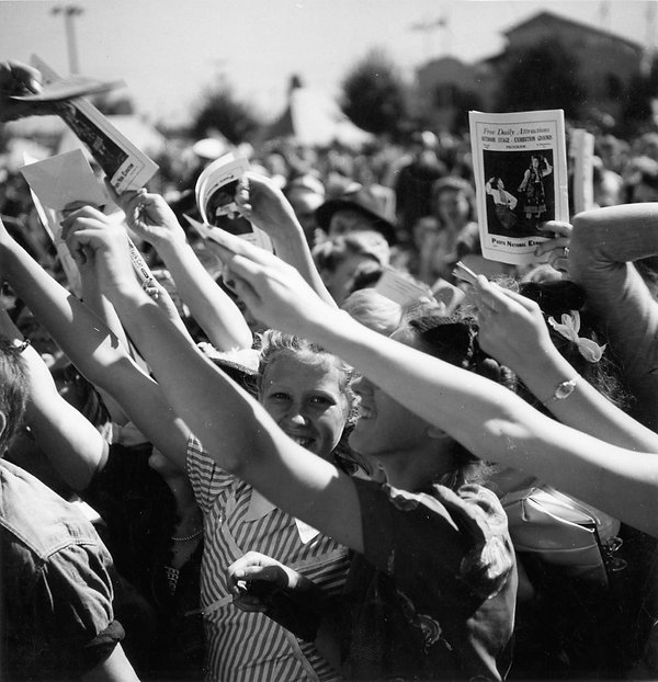 1950 Girls in crowd on P.N.E. grounds.jp