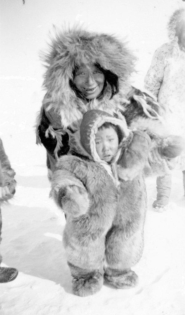 1940 Eskimo grandmother and child wearin