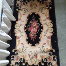 small black and cream floral Oriental-style rectagular rug