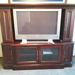 panasonic flat screen TV in mahogany cabinet