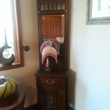 reproduction mahogany entryway hall tree stand with beveled mirror and brass hooks