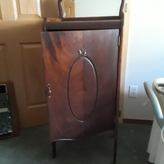 antique mahogany music cabinet with door and mirror