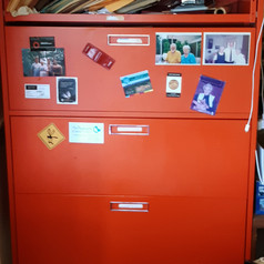 bright red vintage metal tall filing cabinet