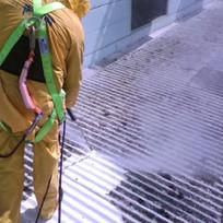 Power washing a metal roof.jpeg