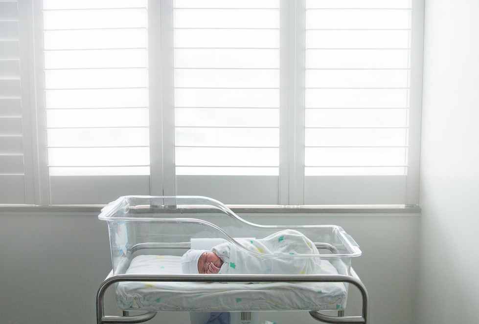 Fresh48 newborn in crib.jpg