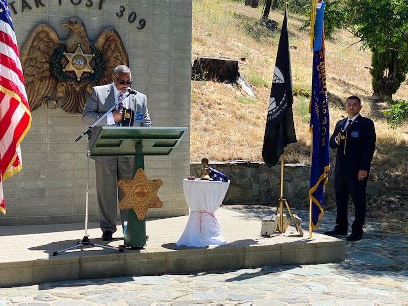 Chaplain Hugh offering the Opening Prayer