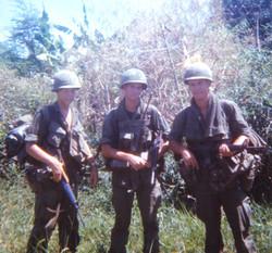 Norm Campbell 1968 Vietnam (center)