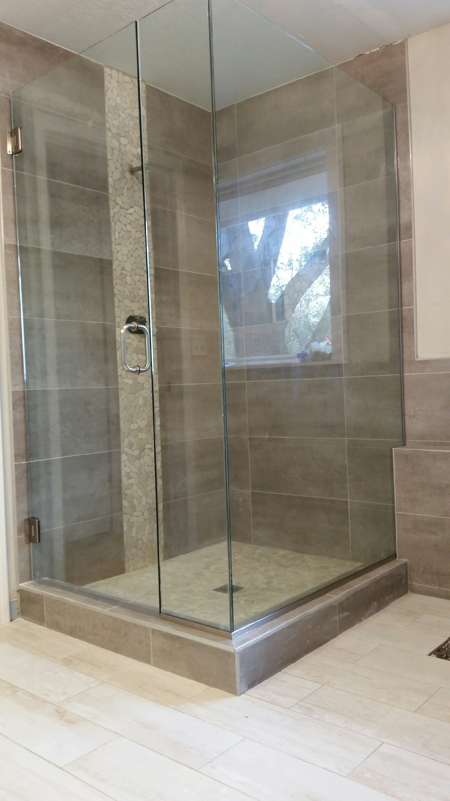Frameless hinged shower enclosure