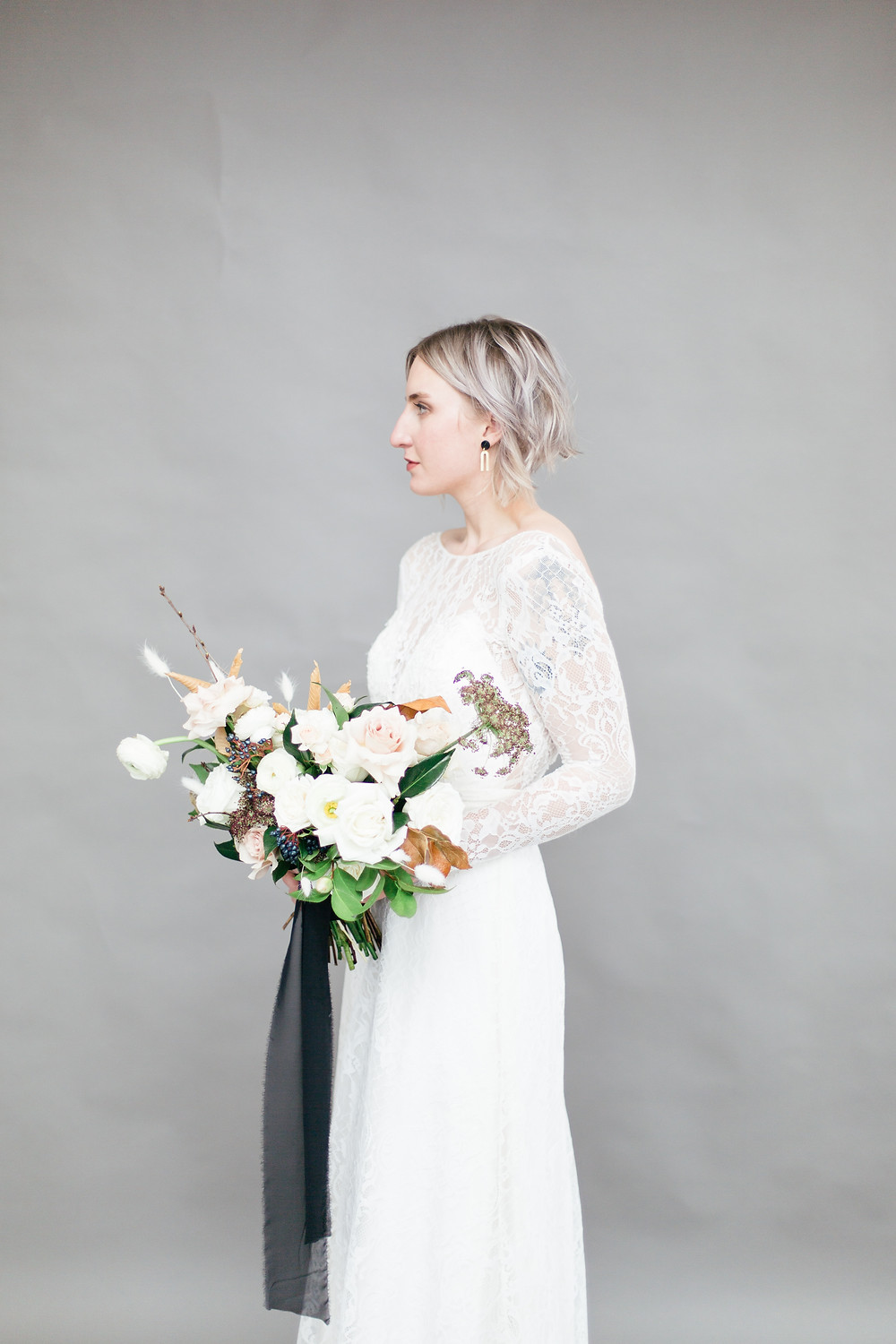 Styled shoot with Katrina Tuttle gown, Little thistle florals, Studs astray jewelry, Graceful weddings event coordination and Bowers construction venue