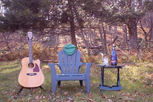 Kevin Campion's album cover for Point of View CD.  His guitar, his hat, and his wine.