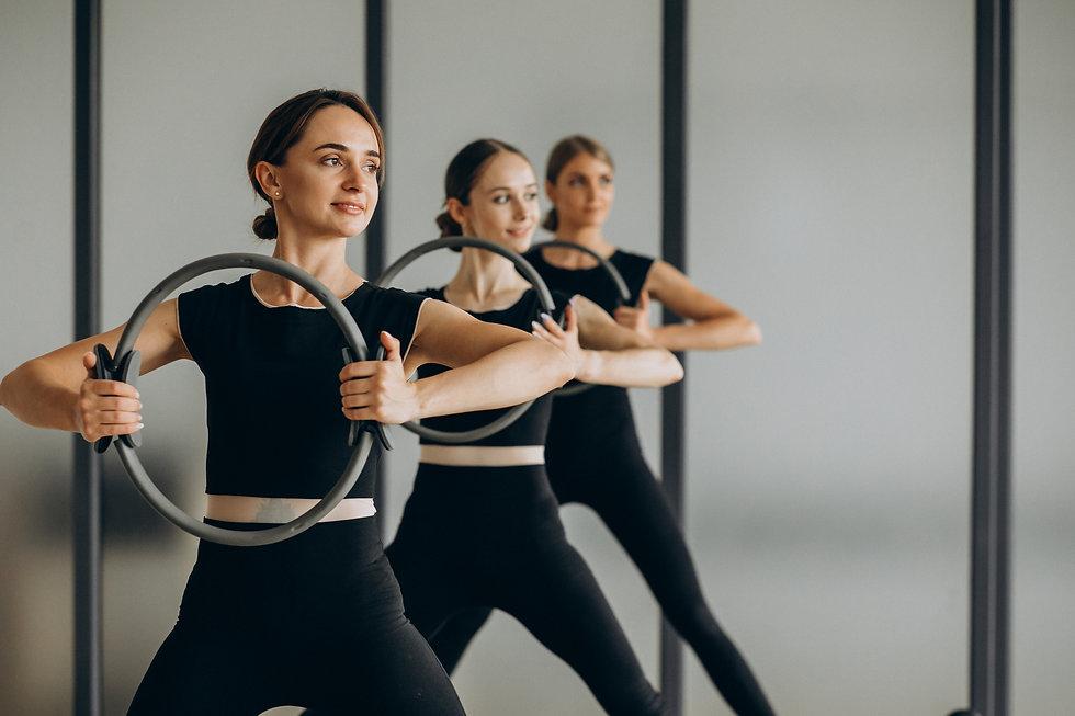group-pilates-instructors-exercising-ref