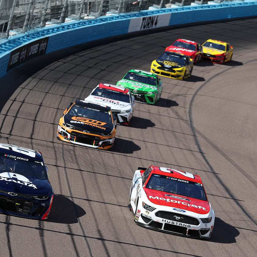 Alex Bowman, driver of the #88 Axalta Chevrolet, races Matt DiBenedetto, driver of the #21 Motorcraft/Quick Lane Ford, during the NASCAR Cup Series FanShield 500 at Phoenix Raceway on March 08, 2020 in Avondale, Arizona. (Photo by Chris Graythen/Getty Images)