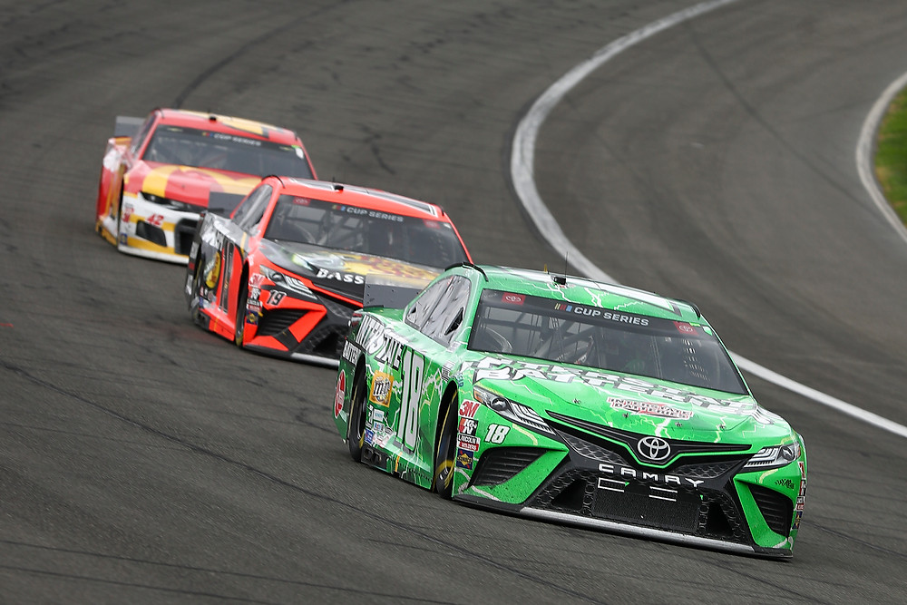FONTANA, CALIFORNIA - MARCH 01: Kyle Busch, driver of the #18 Interstate Batteries Toyota, leads a pack of cars in the NASCAR Cup Series Auto Club 400 at Auto Club Speedway on March 01, 2020 in Fontana, California.