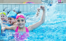 happy children kids group at swimming po