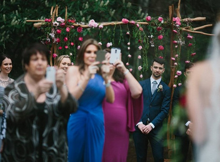 A photographer's plea to wedding guests has gone viral