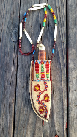 Beaded Neck Knife Sheeth Geometric and floral beaded necklace