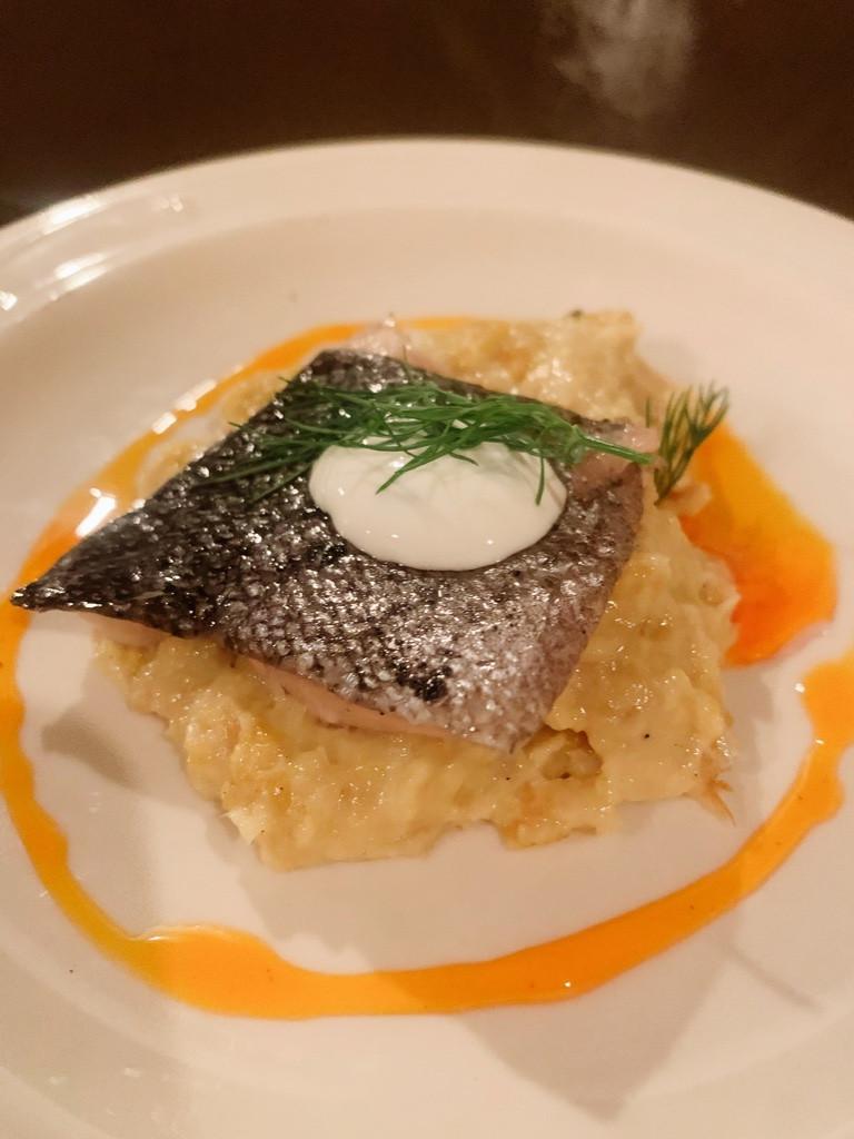 Pan seared fish over creamy polenta
