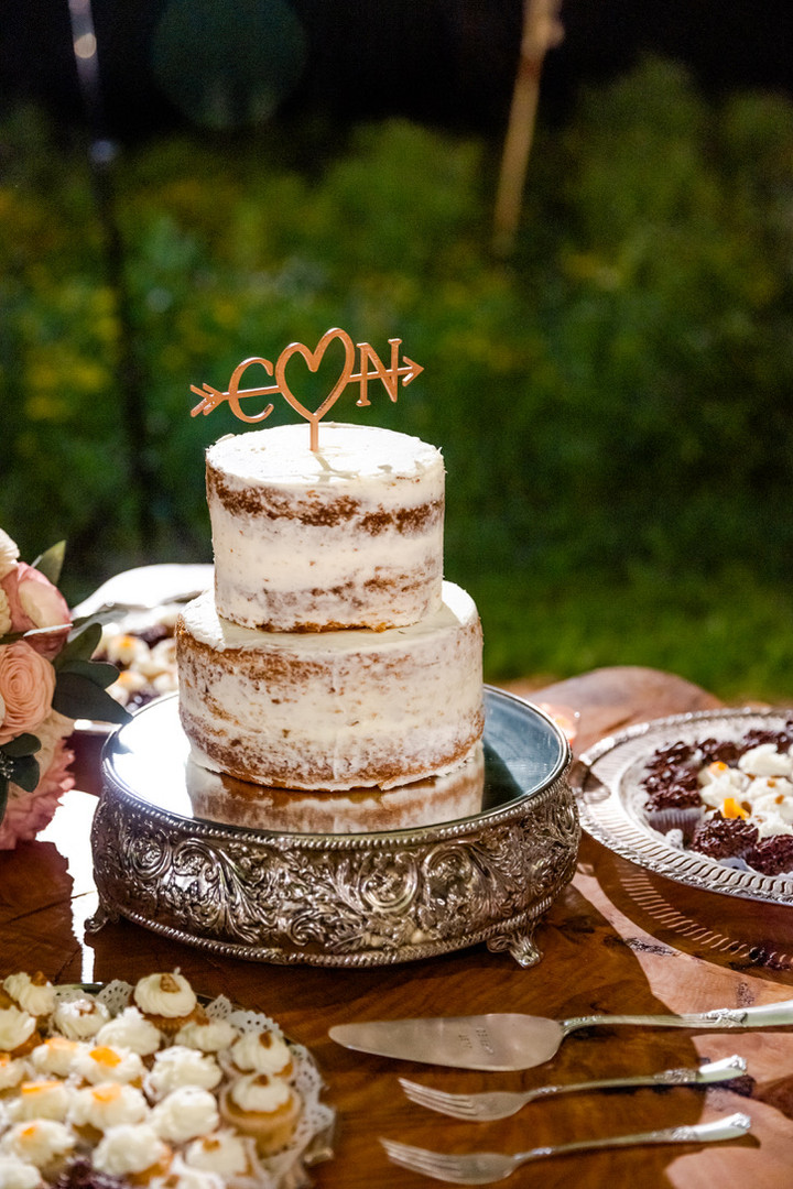 wedding cake and cupcakes display