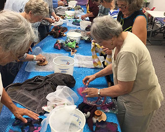 Members try their hand at felting during one of our programs