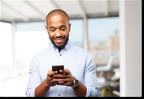 Dark skinned man holding a smart phone