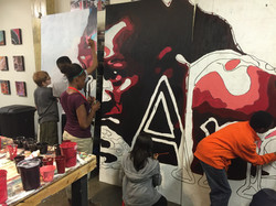 A+UP  working on Jesse Owens mural
