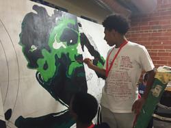 Jahlani working on Jesse Owens mural