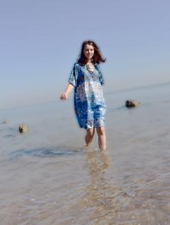 Anais wading through the arafura sea in blue mangrove motif on indian cotton silk