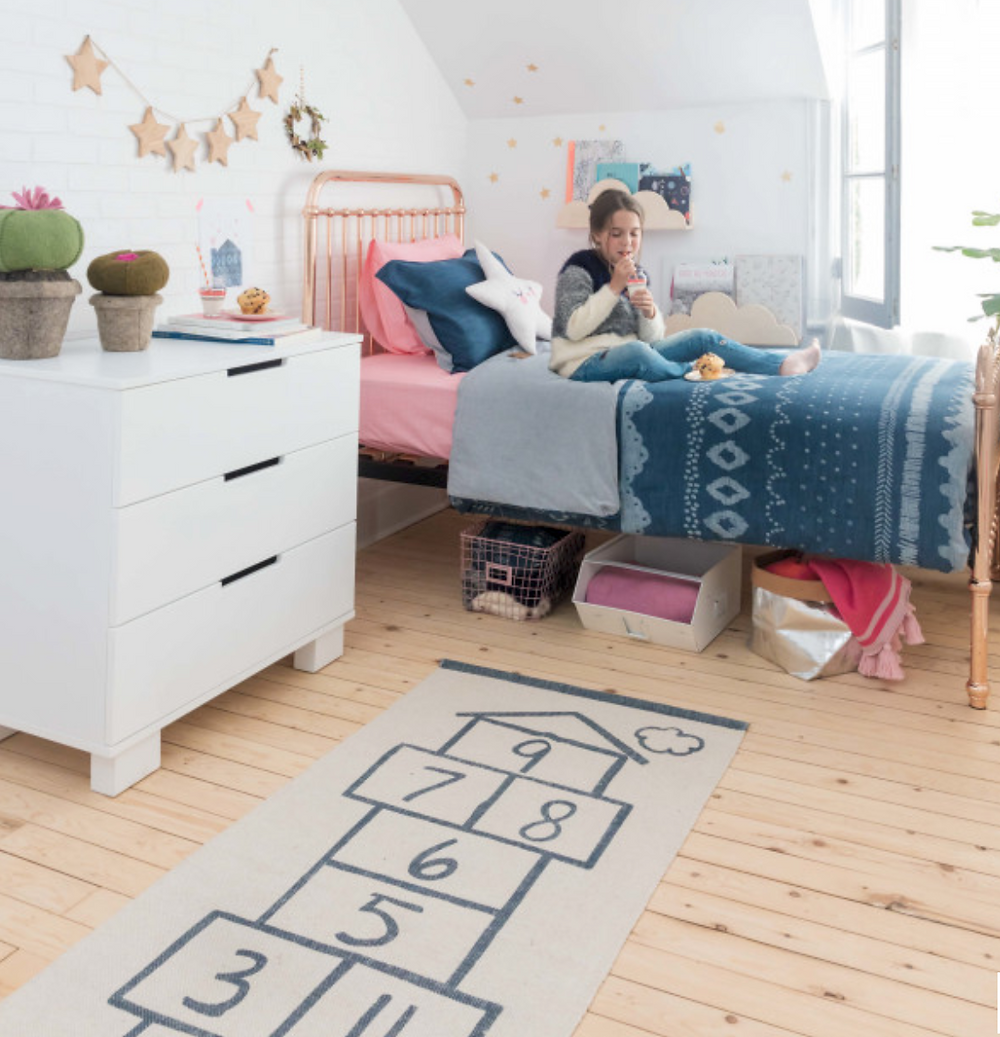 Kids room decor mixing denim with other materials