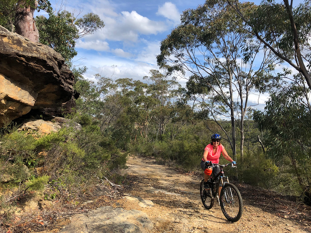 Ruth Henderson mountain biking along Springwood Ridge Trail.