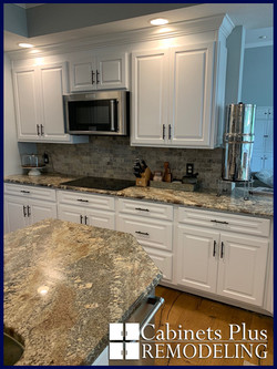 White raised panel with crown and granit