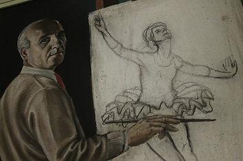 Autoritratto di Guerrino Vitali con il pennello in mano mentre dipinge una ballerina