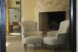 Stone Fireplace and Club Chairs