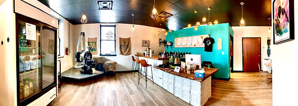 This is the interior of the Cleveland Coffee Shop Scoot Cold Brew which allows for small business meetings in the meeting room.