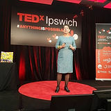 Megan-on-the-red-dot-tedx-Ipswich.jpg