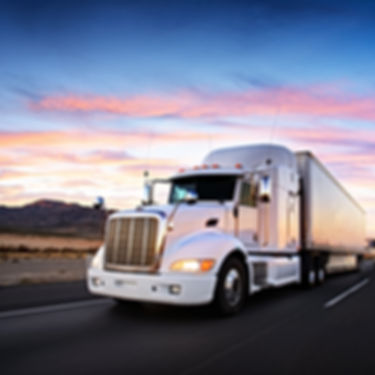 Truck and highway at sunset - transporta