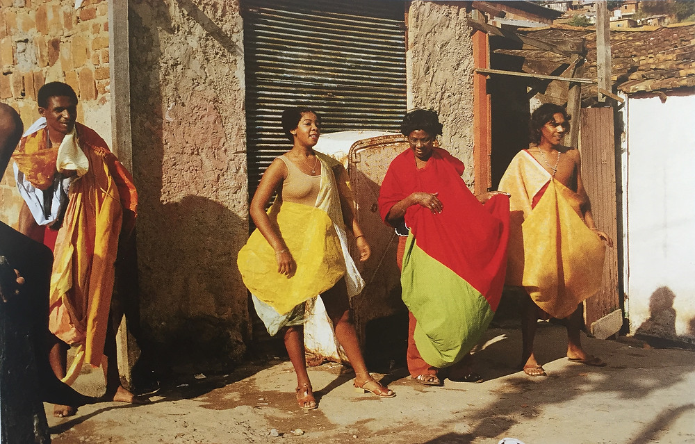 Parangoles capes by artist Helio Oiticica worn by people in Mangueira Hill, Brazil.