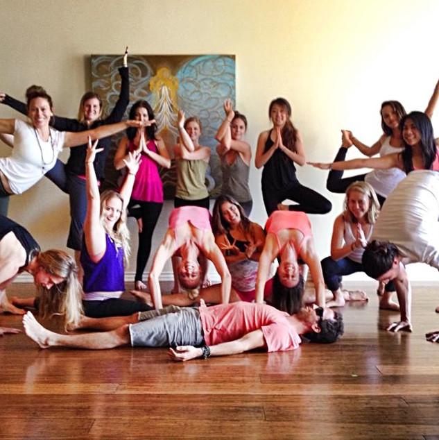 newly graduates of yoga teachers travis eliot and lauren eckstrom