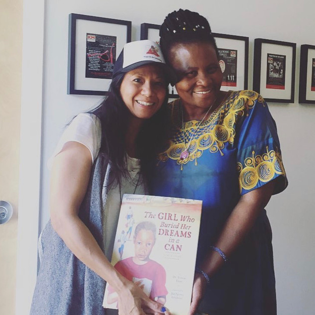 world renowed, humanitarian dr. tererai trent with yoga and art journey amulet